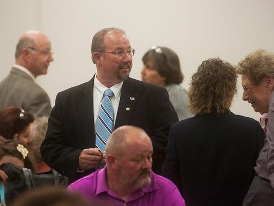Public officials such as Rep. Dan Moul speak with the crowd at SAVES for townhall meeting on medical marijuana on May 1.