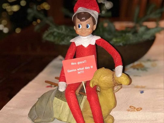 Elf on the Shelf having fun on a Wednesday. The sign
