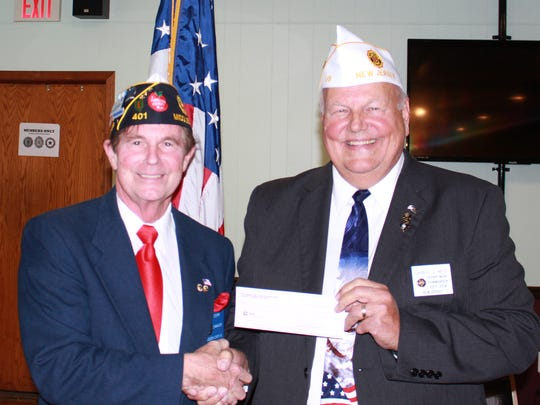 Gary Cooper (left), Middlesex County American Legion commander, made a $1,000 donation from the county organization to State Cmdr. Darryl Reid for his state project.
