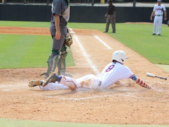 Louisiana Tech third baseman Chase Lunceford slides