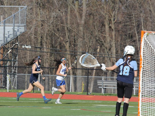 Hannah Schwartz (#4 in white) heads to the goal during