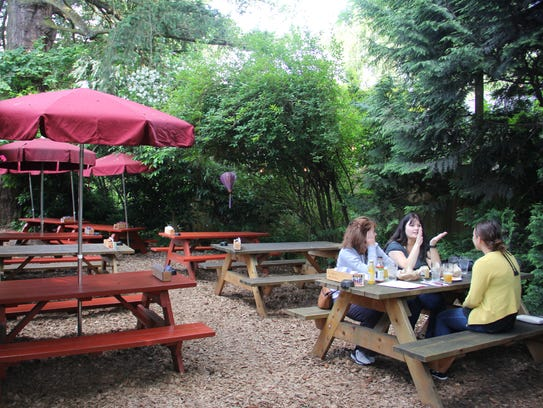 Guests eat outside in Thompson Brewery's large outdoor