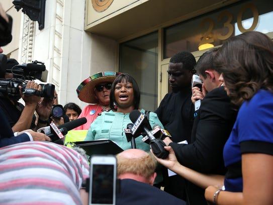 Terina Allen, sister of Sam DuBose, addresses the press