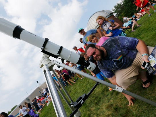 Sean Yarborough of Johnson City views the solar eclipse