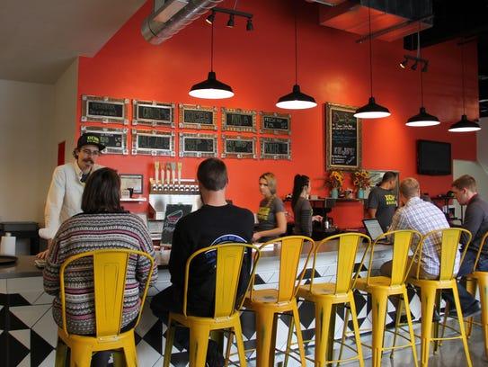 Brewer Matt Dakopolos chats with restaurant guests