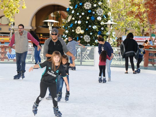 Skaters of all ages Saturday enjoy the ice rink built