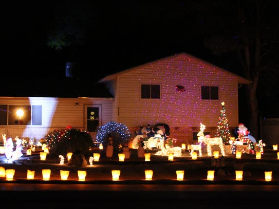 Luminarias are featured in this classic holiday light display at 2825 Huntington Drive.