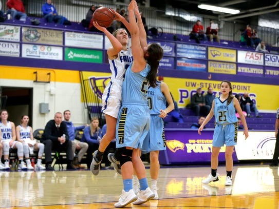 Amherst player Lindsay Dose is blocked by St. Mary's