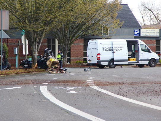 Salem police and fire officials clear the scene of