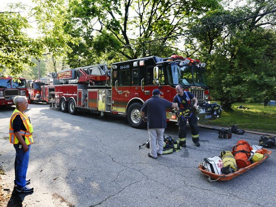 Firefighters from Neptune, and Wall Township work the scene of a house fire at Prospect Place. Neptune,NJ. Tuesday, May 15, 2018 Noah K. Murray-Correspondent Asbury Park Press