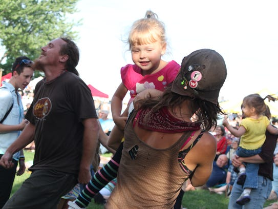 Shaundra Perlak of Stevens Point dances with her daughter,