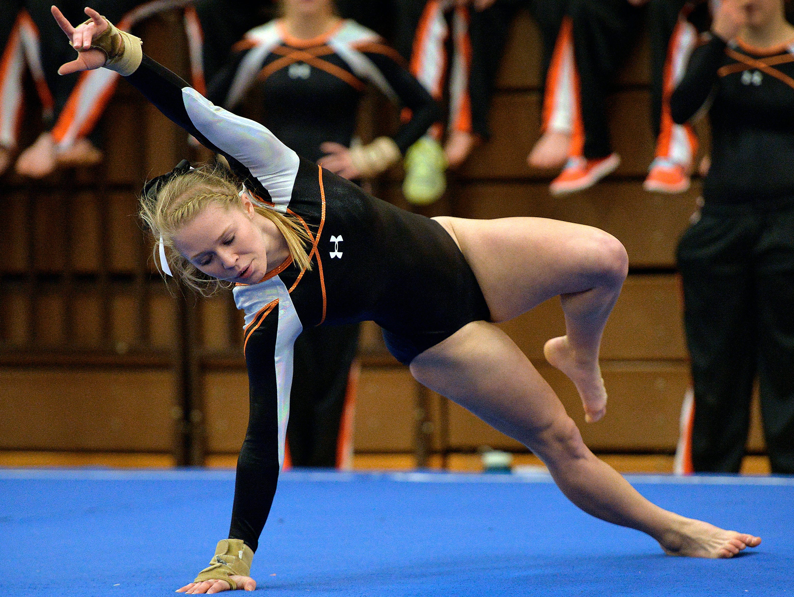 St. Cloud Tech senior gymnast Kalley Thompson performs during her floor exercise routine Saturday, Dec. 5 in the St. Cloud Apollo Gymnastics Invite.