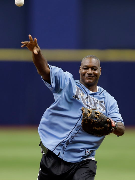 Former Tampa Bay Buccaneers linebacker Derrick Brooks throws out the ceremonial first pitch before a baseball game between the Tampa Bay Rays and the Boston Red Sox, Sunday, July 27, 2014, in St. Petersburg, Fla. Brooks will enter the NFL football Hall of Fame next Saturday. (AP Photo/Chris O'Meara)
