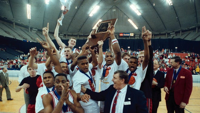 Richmond High School's boys basketball team celebrates winning the state championship on March 28, 1992.