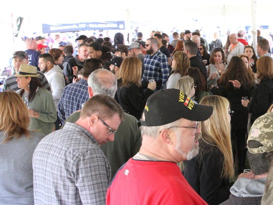 People enjoy the first annual Tilly's Table Beerfest