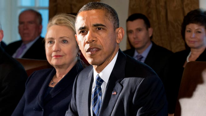 FILE - This Nov. 28, 2012 file photo shows then-Secretary of State Hillary Rodham Clinton listening as President Barack Obama speaks in the Cabinet Room at the White House in Washington. The White House confirmed that Hillary Clinton had lunch with President Obama Thursday. (AP Photo/Jacquelyn Martin, File)