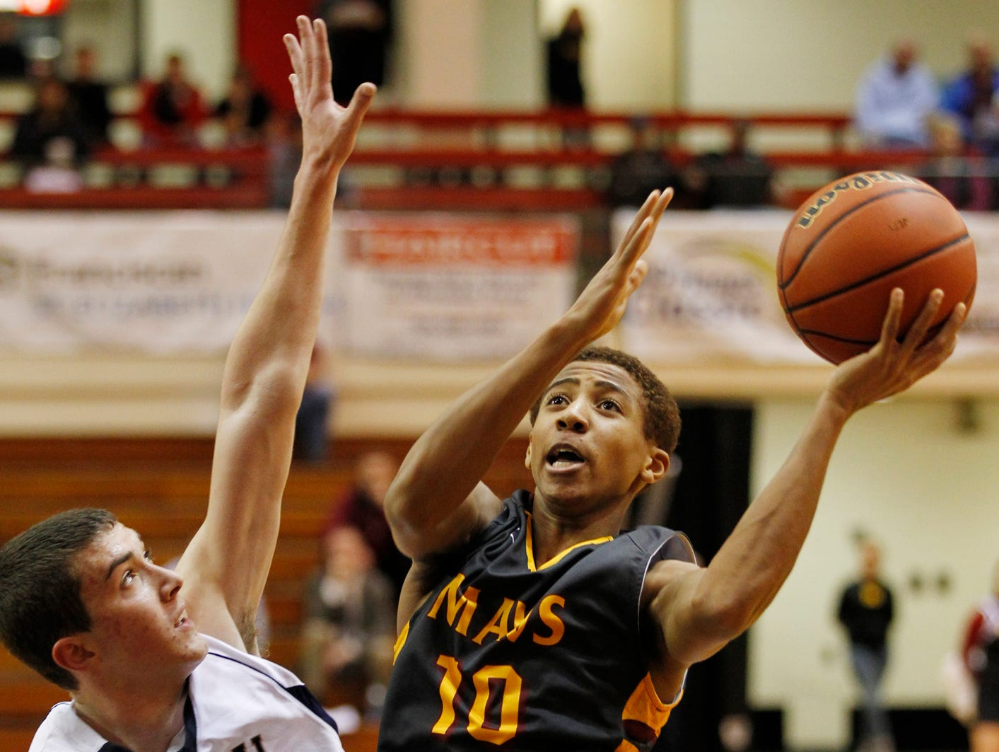 McCutcheon's Robert Phinisee with a shot over Trent Thompson of Central Catholic in the J&C Hoops Classic Tuesday, December 1, 2015, at Lafayette Jeff. McCutcheon won in a landslide 114-44 over Central Catholic.
