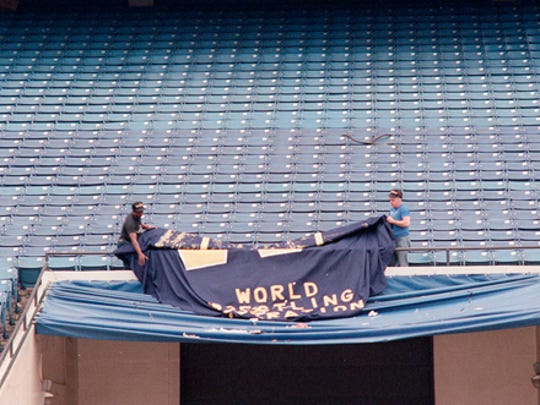 Crews take down WWF signage the day after WrestleMania III. Media reports from the time say the Silverdome was littered with trash.