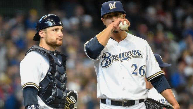 Milwaukee Brewers pitcher Kyle Lohse talks with catcher Jonathan Lucroy in the fourth inning as he waits to be taken out of the game Monday against the Colorado Rockies at Miller Park. Lohse gave up 8 runs and was charged with the loss as the Rockies beat the Brewers 10-0.