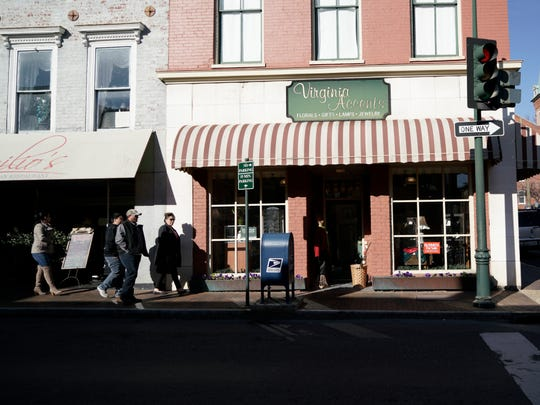 People walk past Virginia Accents in downtown Staunton