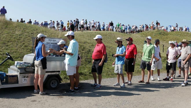 Golf fans line up to buy refreshments at the PGA Championship Saturday at Whistling Straits near Haven.