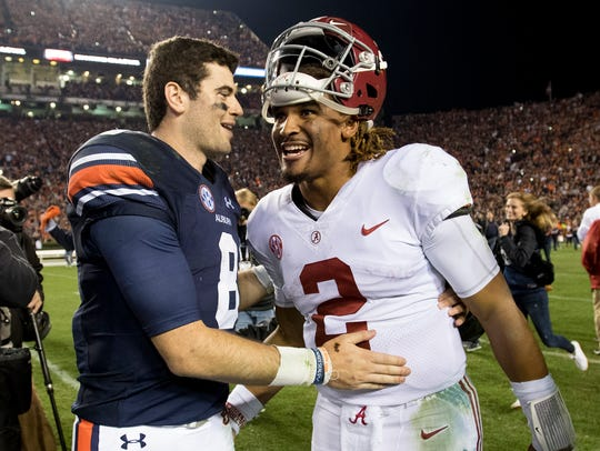 Auburn quarterback Jarrett Stidham (8) and Alabama