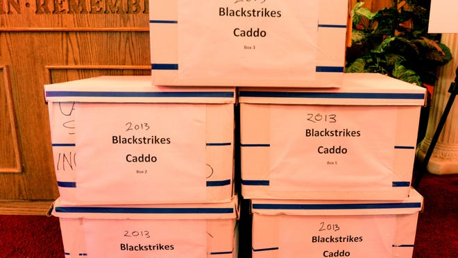 Boxes containing some jury trial documents examined by Reprieve Australia, which conducted the Blackstrikes report on the Caddo Parish District Attorney's use of peremptory challenges to strike qualified black jurors from trials.