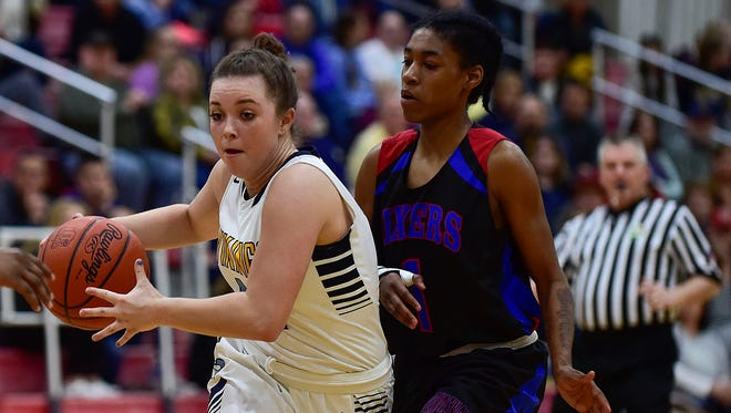 River Valley senior point guard Morgan Lott drives to the basket during a Division II district tournament game with Independence. Lott was named Central District Player of the Year in Division II girls basketball.