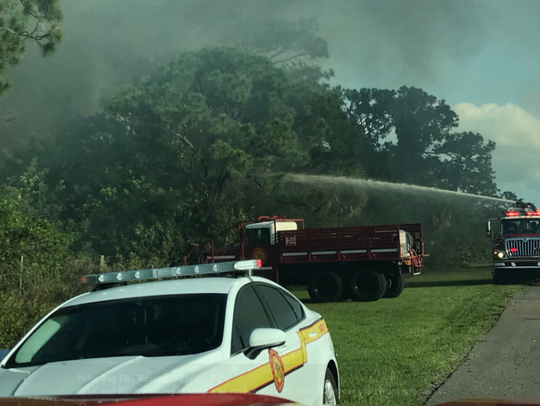 Palm Bay Fire Rescue and BCFR fighting a fire near