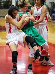 Ballinger's Vivian Guerrero and Wall's Jayden Fiebiger fight for the ball Friday, Jan. 12, 2018, at Ballinger gym.