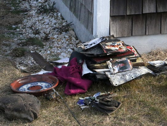 Personal belongings, keepsakes and memories are piled in front of the garage of one of the houses on Bay Avenue in Slaughter Beach that was destroyed by fire Christmas night.