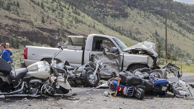 The scene of an accident in which five motorcycles (three pictured) and a pickup collided on the North Fork Highway west of Cody, Wyo., on Thursday. Three fatalities were reported.