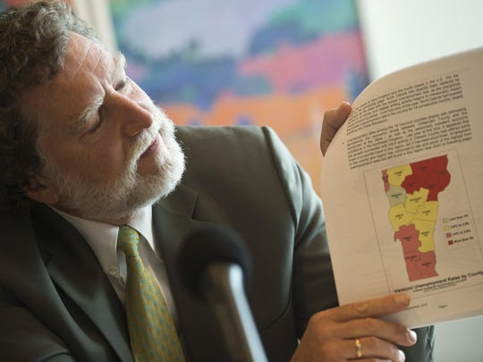 Economist Thomas Kavet shows a color-coded map of Vermont, showing unemployment rates, during a budget meeting at the governor's office in Montpelier on Monday morning. Kavet pointed out that the Northeast Kingdom in Vermont continues to struggle with the highest unemployment rate in the state.