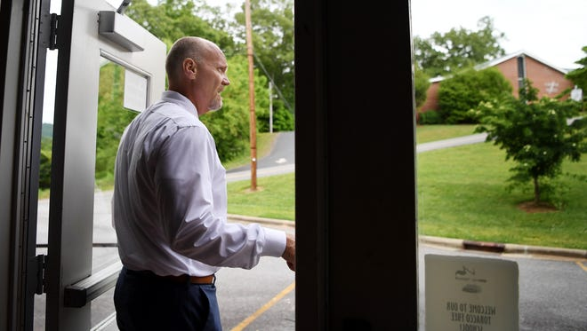 Chris Baldwin, Macon County Schools superintendent, looks out of one of the many entrances at Franklin High School May 17, 2018.