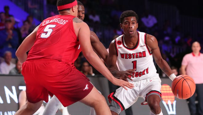 Nov 24, 2017;  Paradise Island, BAHAMAS; Western Kentucky Hilltoppers guard Lamonte Bearden (1) dribbles as Southern Methodist Mustangs forward Ethan Chargois (5) defends during the second half in the 2017 Battle 4 Atlantis in Imperial Arena at the Atlantis Resort. Mandatory Credit: Kevin Jairaj-USA TODAY Sports