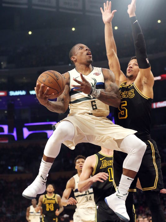 Milwaukee Bucks guard Eric Bledsoe (6) shoots as Los Angeles Lakers forward Josh Hart (5) in the first half of an NBA basketball game in Los Angeles Friday, March 30, 2018. (AP Photo/Reed Saxon)