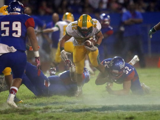 Coachella Valley's Jose Marquez carries the ball against Indio on Friday, September 15, 2017 in Indio.
