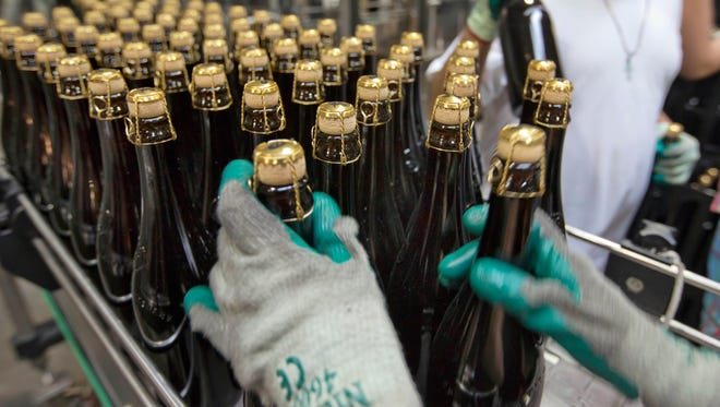 Bottles of Brooklyn Local 2 are loaded on to a conveyor for labeling at the Brooklyn Brewery, in the Williamsburg section of the Brooklyn borough of New York.
