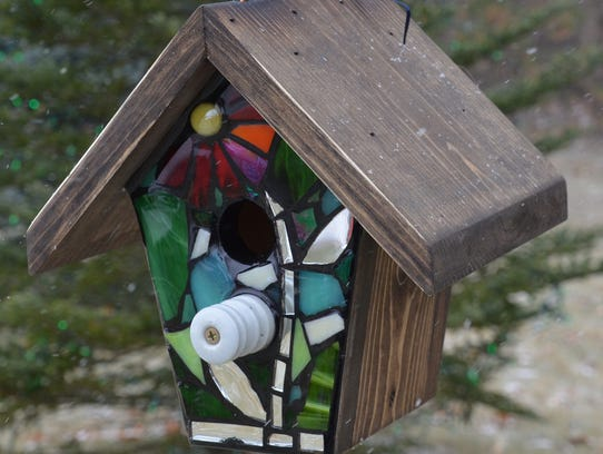 Kimberly Moon Young makes stained glass mosaic birdhouses