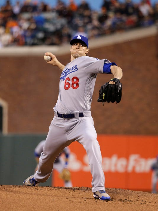 Los Angeles Dodgers starting pitcher Ross Stripling (68) throws to a San Francisco Giants batter during the first inning of a baseball game Friday, April 8, 2016, in San Francisco. (AP Photo/Marcio Jose Sanchez)