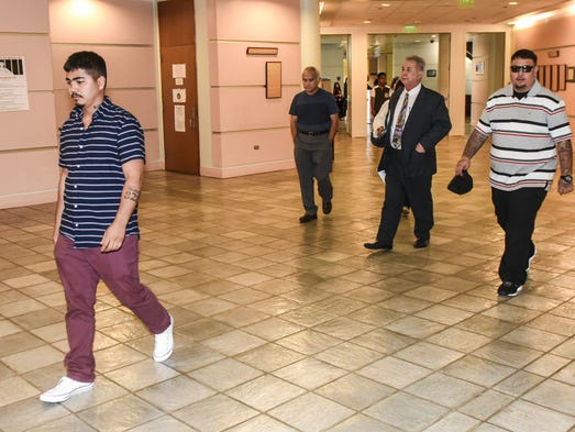 Defendant Liberty Joe Concepcion, left, is seen entering