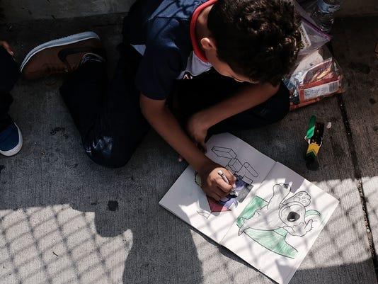 Despite Trump's Executive Order, Thousands Of Migrant Children Still Held In Camps