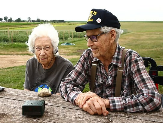 Clare and Wilma Hunter outside their farm house that
