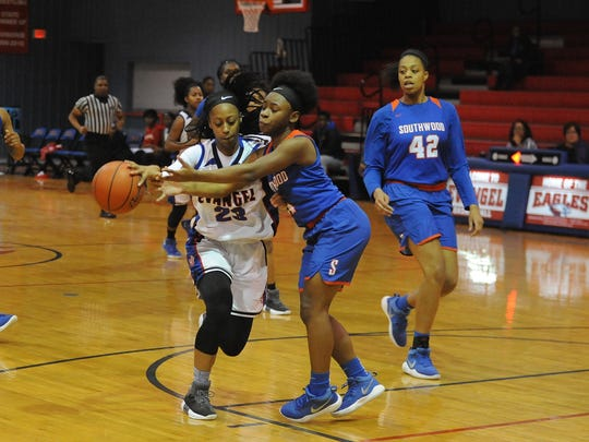 Evagnel's Tiara Young drives to the basket against Southwood Tuesday night.