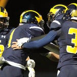 Hartland's Brett Borseth (1) gave his team plenty to celebrate after scoring the winning touchdown Friday night. October is a month where a team's hopes and dreams can come down to one play.