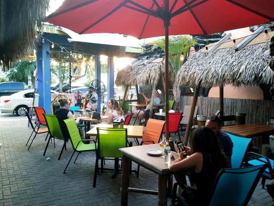 Sneaki Tiki is open air restaurant with a tropical