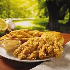 The beer flavor in the Popeyes version -- which is fried, not grilled -- comes from a mixture of marinade seasonings including garlic, butter, rosemary, onion, cayennne pepper, lemon zest and an undisclosed flavoring. At $3.99, the chicken breast is hand-battered, cut into three strips and served with a spicy dipping sauce, Cajun fries and a biscuit.