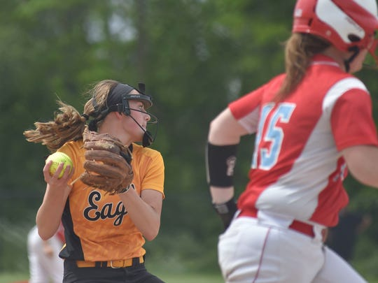 Colonel Crawford's Sydney Studer fields a ball and prepares to throw to first during Colonel Crawford's regional semi-final loss to Eastwood Wednesday at Findlay.