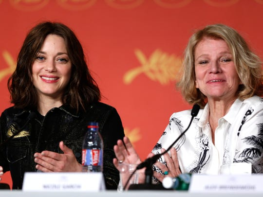 """Actress Marion Cotillard (left) and director Nicole Garcia attend the """"From the Land of the Moon"""" media conference at the Cannes Film Festival."""