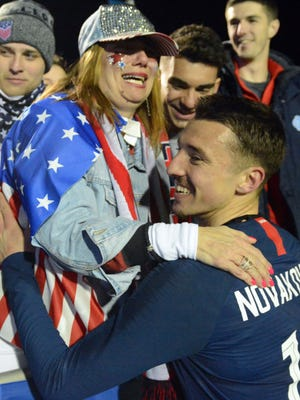 United States forward Andrija Novakovich (18) is greeted by his mother, Zorka (in hat) and brother Rade (in stocking cap) and cousin Luka Prpa during an international friendly men's soccer match against Paraguay on March 27 at WakeMed Soccer Park in Cary, North Carolina. The US won, 1-0.